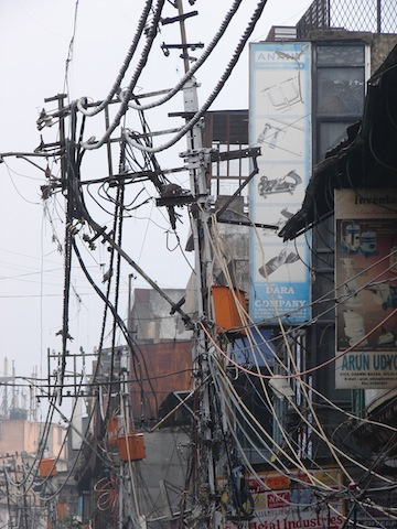 An Electric Pole with Hundreds of Connections in a Crowded Street in Old Delhi